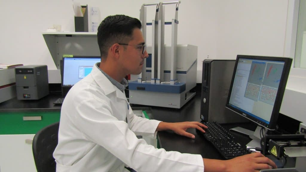 Guillermo Garcia Barrios, a co-author of the study and student at Colegio de Postgraduados in Montecillo, Mexico, with a PHERAstar machine used to validate genetic markers. (Photo: Marcia MacNeil/CIMMYT)