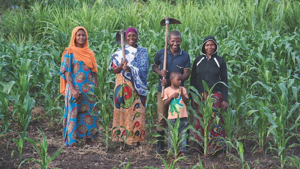 Musa Hasani Mtambo and his family in their conservation agriculture plot in Hai, Tanzania. (Photo: Peter Lowe/CIMMYT)