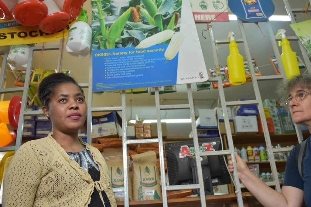 Marianne Banziger (right), CIMMYT's deputy director for research and partnership, listens to a Dryland Seed sales manager during a visit to a farm supplies shop in Machakos, Kenya. (Photo: Jerome Bossuet/CIMMYT)