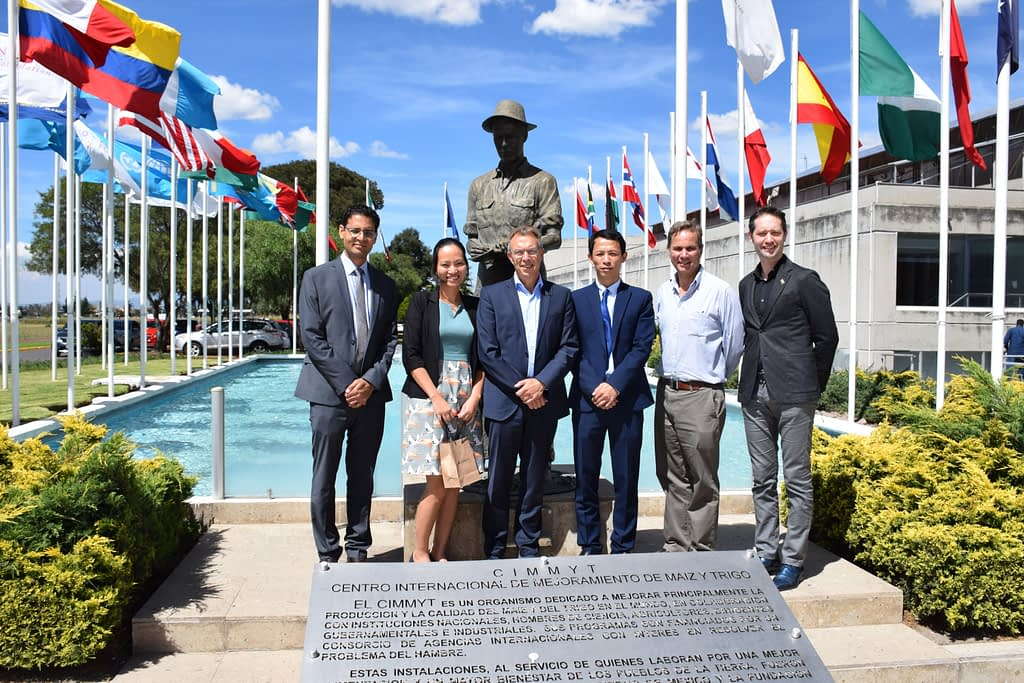 Visitors from the Embassy of Vietnam in Mexico and members of CIMMYT senior management stand for a group photograph next to the Norman Borlaug statue at CIMMYT's global headquarters. (Photo: Jose Luis Olin Martinez for CIMMYT)