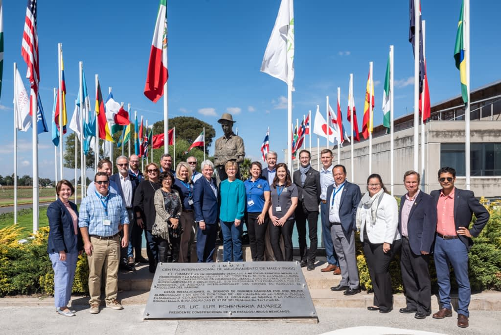The US delegation stands for a group photo next to the sculpture of Norman Borlaug at the global headquarters of CIMMYT. (Photo: Eleusis Llanderal/CIMMYT)