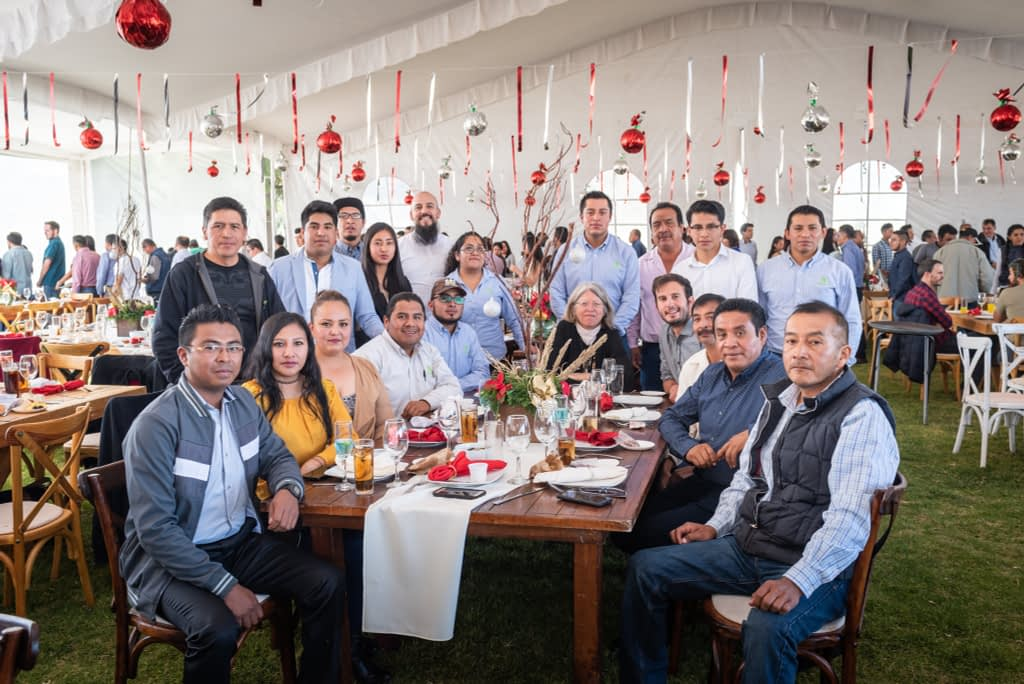 Costich and the Maize Collection team at the 2018 CIMMYT Christmas party. Filippo Guzzon, seated to the right of Costich, had just been offered a postdoc with the team.
