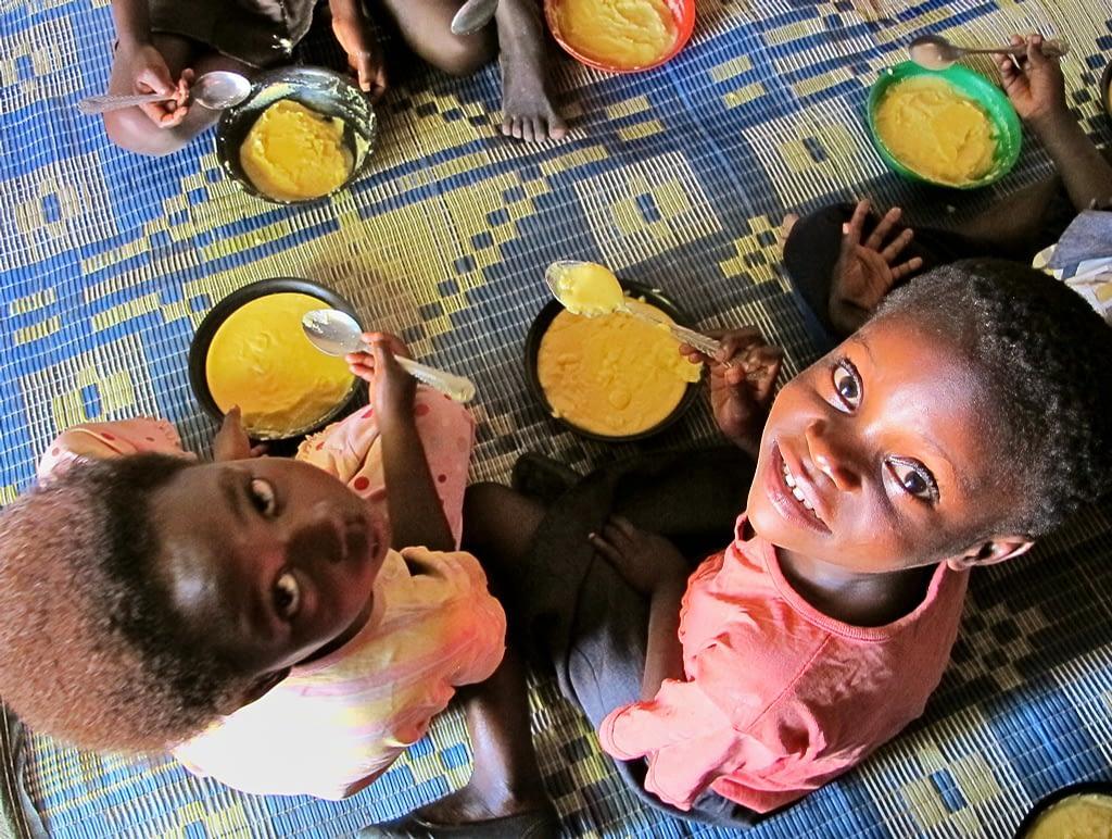 Two girls eat biofortified maize in Mukushi, Zambia. (Photo: Silke Seco/DFID)