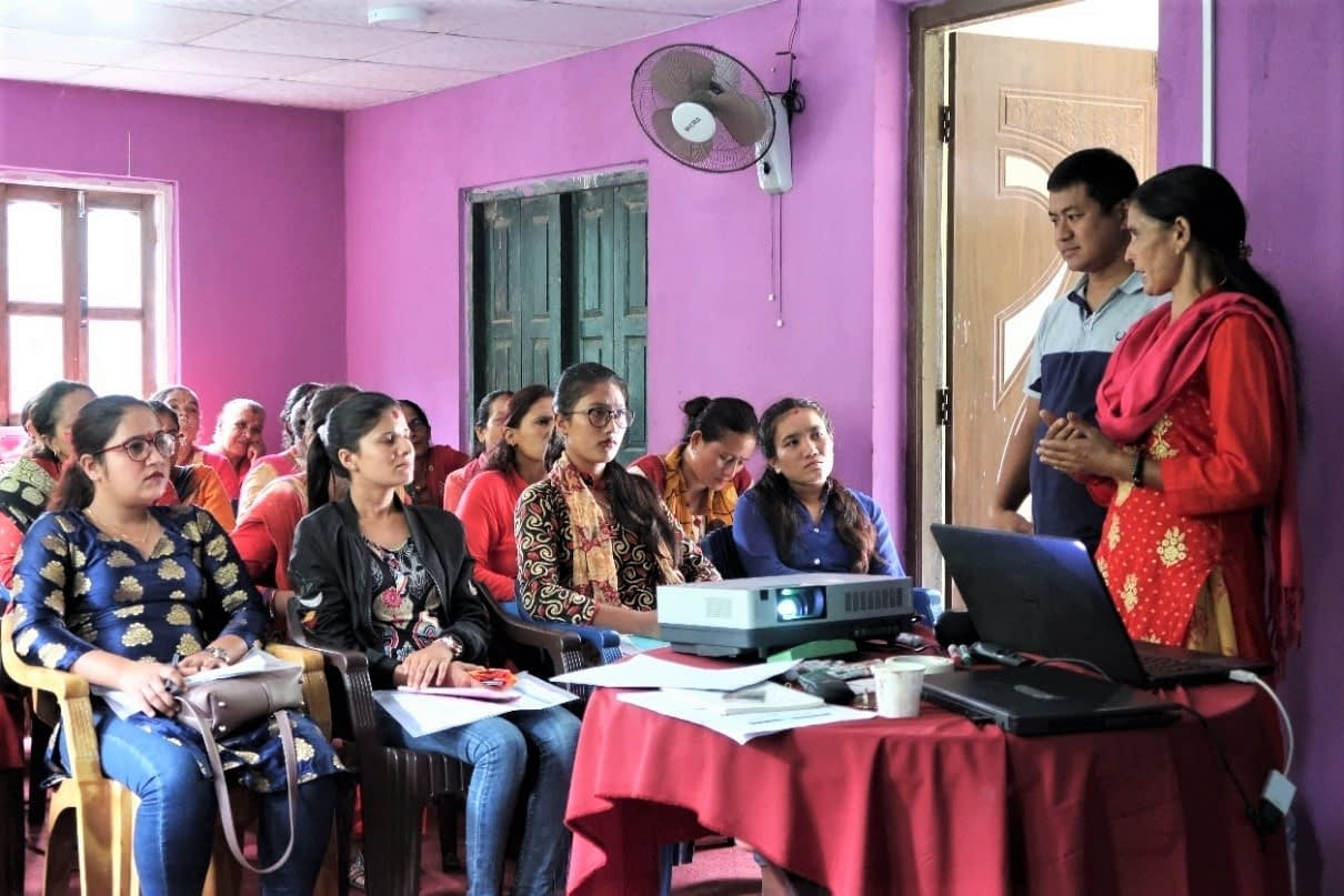 Lead farmer Parbati Gautam shares her experiences on seed production of maize hybrid at a training event.