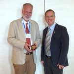 Thomas Payne (left) stands for a photo with CIMMYT's Director of Genetic Resources Kevin Pixley.