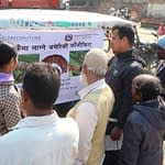 Farmers listen to information about fall armyworm displayed on an auto-rickshaw in Nepal's Banke district. (Photo: Darbin Joshi/CIMMYT)
