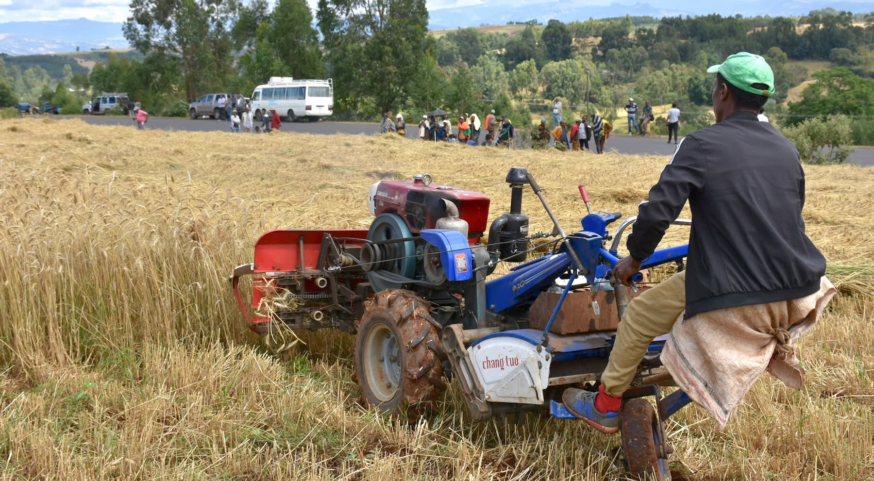 Farmers see a demonstration of how the two-wheel tractor functions. (Photo: Simret Yasabu/CIMMYT)