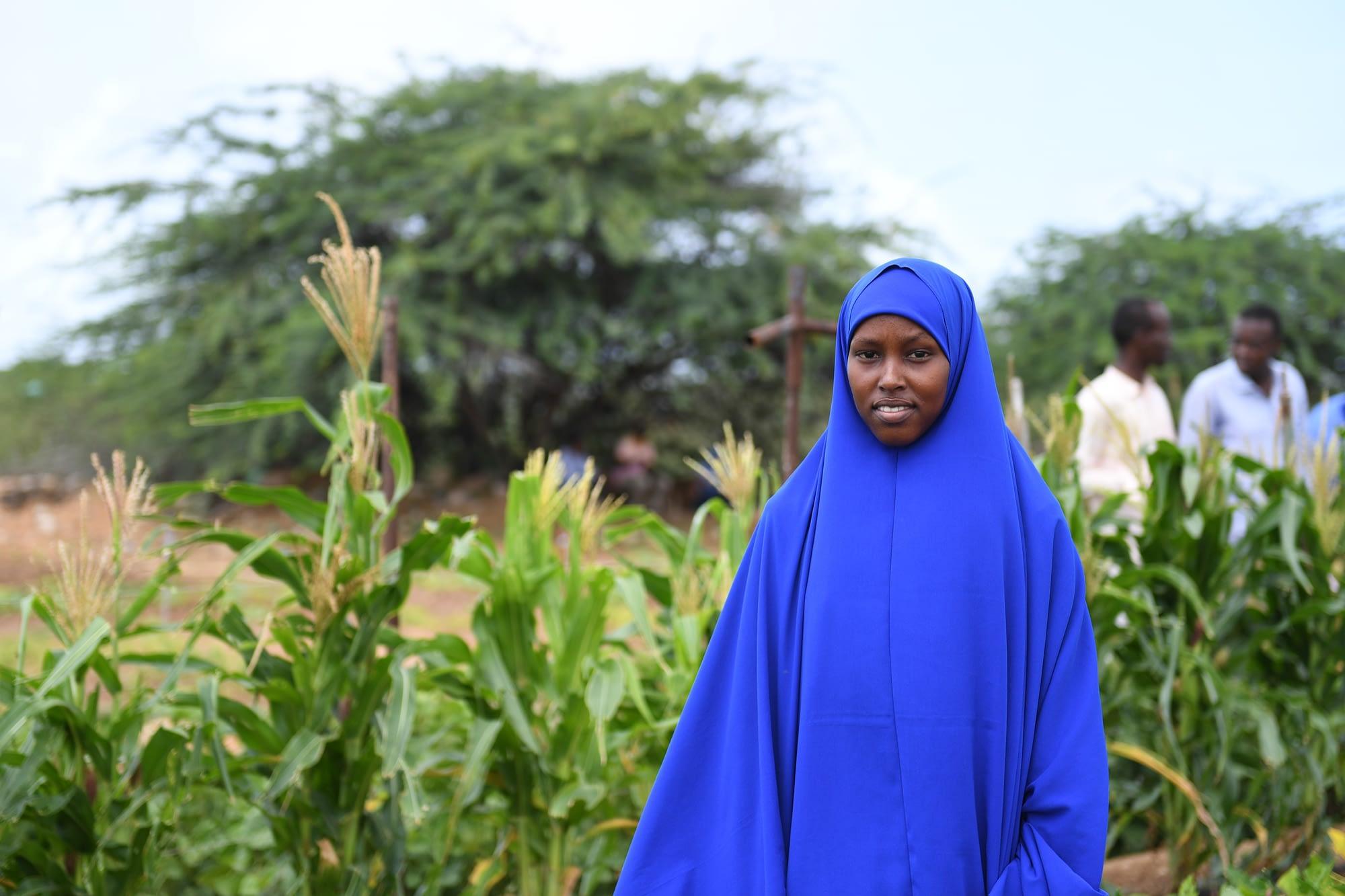 Somali woman in field.