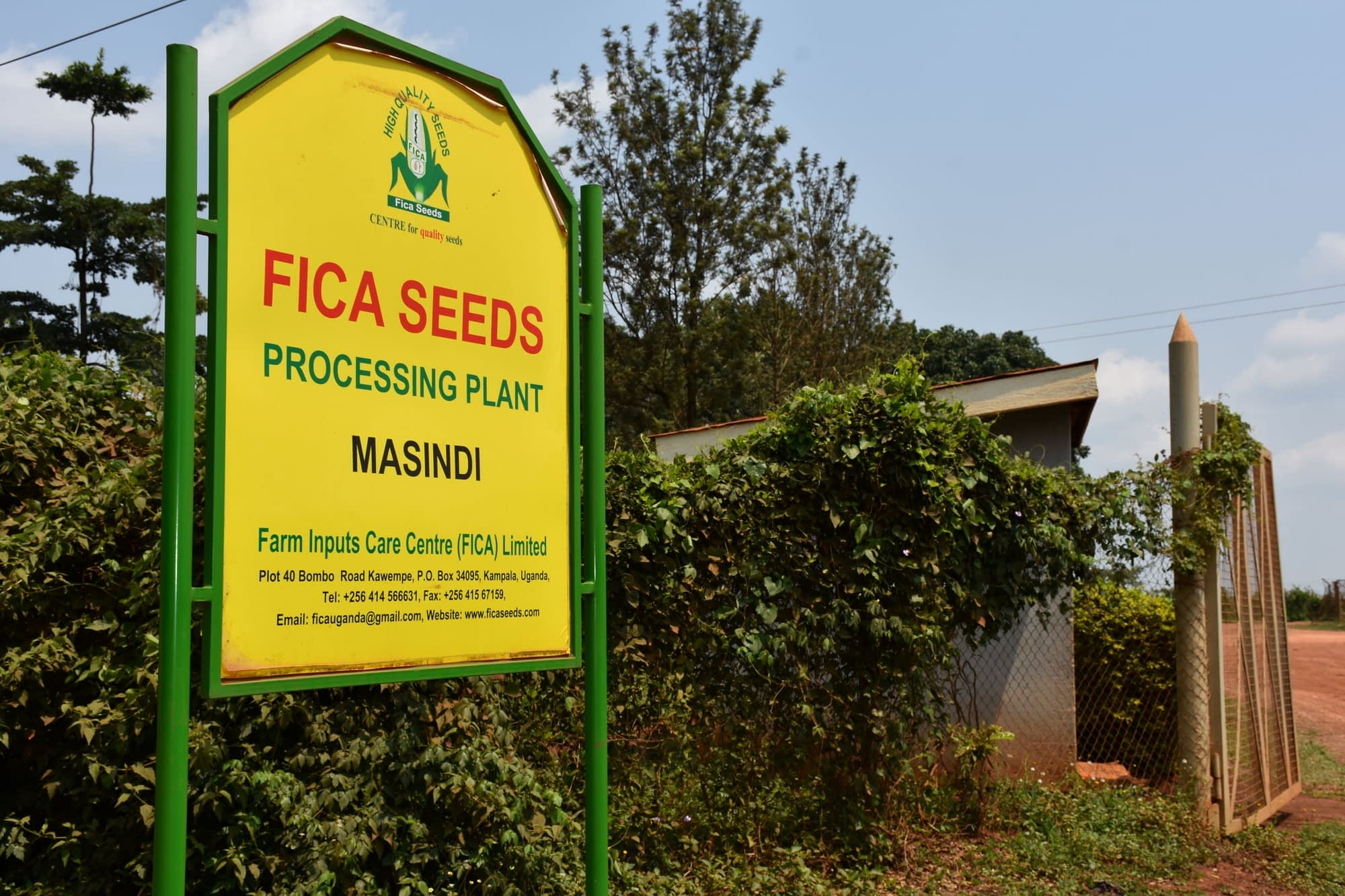 A signpost at the entrance to Farm Inputs Care Centre (FICA) in Masindi, Uganda. (Photo: Joshua Masinde/CIMMYT)