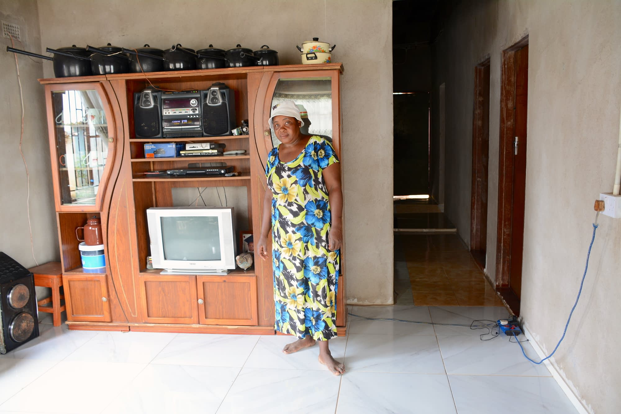 Lilian Chimbadzwa shows the house they were able to build in 2013 using proceeds from lablab sales. (Photo: Shiela Chikulo/CIMMYT)