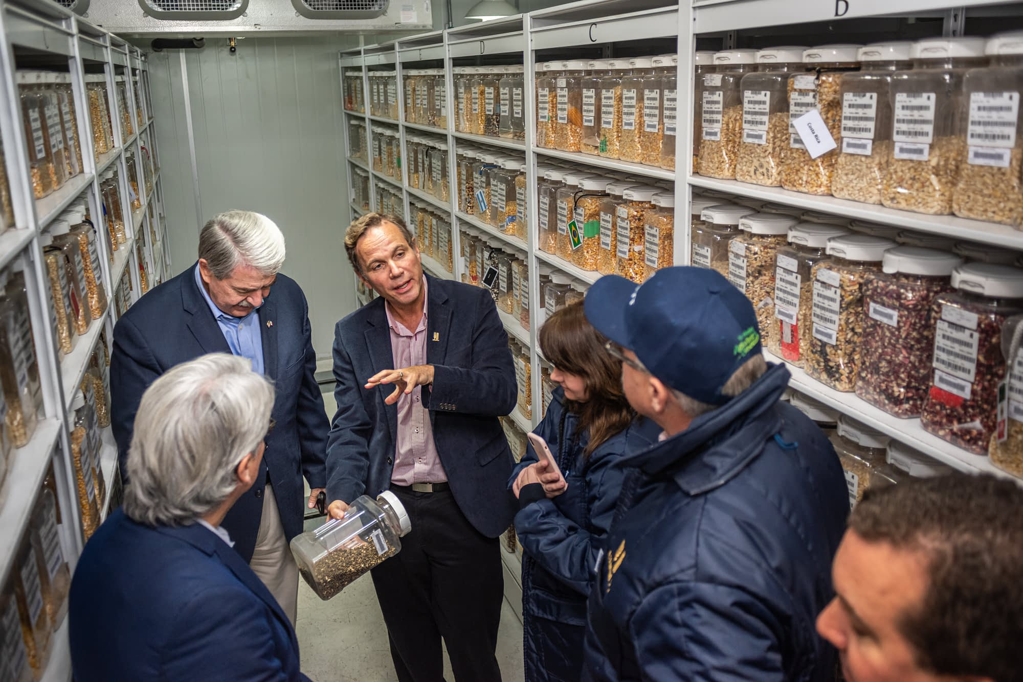 The director of the Genetic Resources program, Kevin Pixley (center), shows some of the genetic materials at CIMMYT's Germplasm Bank to US Under Secretary McKinney (top-left). (Photo: Eleusis Llanderal/CIMMYT)