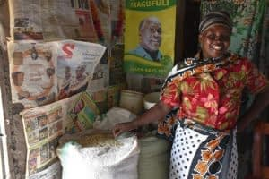 """New hybrid helps farmers beat drought in Tanzania. With seed of a maize hybrid developed by the Drought Tolerant Maize for Africa (DTMA) project and marketed by the company Meru Agro Tours and Consultant Limited, Valeria Pantaleo, a 47-year-old farmer and mother of four from Olkalili village, northern Tanzania, harvested enough grain from a 0.5-hectare plot in 2015 to feed her family and, with the surplus, to purchase an ox calf for plowing, despite the very poor rains that season. """"I got so much harvest and yet I planted this seed very late and with no fertilizer,"""" said Pantaleo, who was happy and surprised. """"I finally managed to buy a calf to replace my two oxen that died at the beginning of the year due to a strange disease."""" In 2015 Meru Agro sold 427 tons of seed of the hybrid, HB513, known locally as """"ngamia,"""" Kiswahili for """"camel,"""" in recognition of its resilience under dry conditions. The company plans to put more than 1,000 tons of seed on the market in 2016. Photo: Brenda Wawa/CIMMYT"""