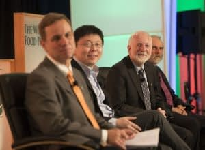 "Speakers on panel ""How Can CRISPR-Cas Technology Assist Small Holder Farmers Around the World?"" at the 2017 Borlaug Dialogue in Des Moines Iowa. L-R: Kevin Pixley, leader of the Seeds of Discovery project and the Genetic Resources Program at CIMMYT; Feng Zhang, core member of Broad Institute; Neal Gutterson, a member of CIMMYT's board of trustees and vice president of research and development at DuPont Pioneer, part of the agriculture division at DowDuPont; Nigel Taylor, interim director of the Institute for International Crop Improvement at Donald Danforth Plant Science Center. Picture credit: World Food Prize"
