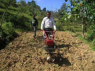 Farmer-uses-minitiller-in-Nepal