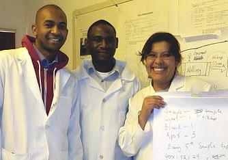 From L-R: John Banda, Ndashe Kapulu, and Alejandra Miranda working in the lab, August 2015. Photo courtesy of Alejandra Miranda.