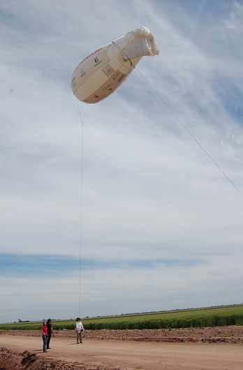Cameras and other sensors mounted on flying devices like this blimp [remote-control quadcopter] provide crop researchers with important visual and numerical information about crop growth, plant architecture and photosynthetic traits, among other characteristics. Photo: Emma Quilligan/CIMMYT