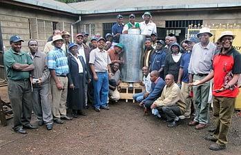 Delegates stand with a modified metal silo at a workshop at the Baraka Agricultural College in Molo, Nakuru County, Kenya. Photos: Wandera Ojanji/CIMMYT