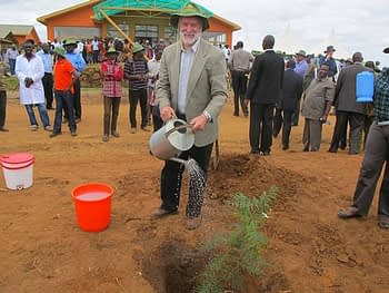 Thomas Lumpkin waters a commemorative tree seedling he planted after the inauguration of the DH Facility in Kiboko. Photo: Wandera Ojanji