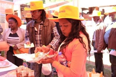 Food industry representatives taste test foods made with vitamin A orange maize at an open day. Photo: Matthew O'Leary/ CIMMYT