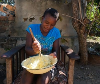 Ashley's mother, , prepares fritas made with vitamin A maize grown on their family farm. Photo: Matthew O'Leary/ CIMMYT
