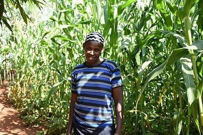 """""""I learned about intercropping from an extension agent and decided to try it out on a small plot, before planting in the larger plot,"""" Hellen Owino shares, adding, """"I think I'm now ready to plant on the larger piece of land. Even though some Striga plants emerge, I'm able to weed them out before they flower, and my yield is not severely affected."""" Photo: K. Kaimenyi/CIMMYT"""