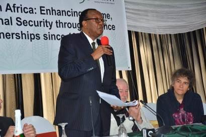Zimbabwe's Minister of Agriculture, Mechanization and Irrigation Development, addresses the CIMMYT50 commemoration in Harare, Zimbabwe. Photo: Johnson Siamachira/CIMMYT.