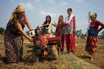 Women use a mini-tiller for direct seeding in Ramghat, Surkhet, Nepal. (Photo: P. Lowe/CIMMYT)