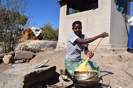 A farmer prepares Sadza to be used in the taste evaluation exercise. R.Lunduka/CIMMYT