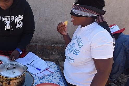 Blindfolded farmer takes part in the taste evaluation exercise. R. Lunduka/CIMMYT