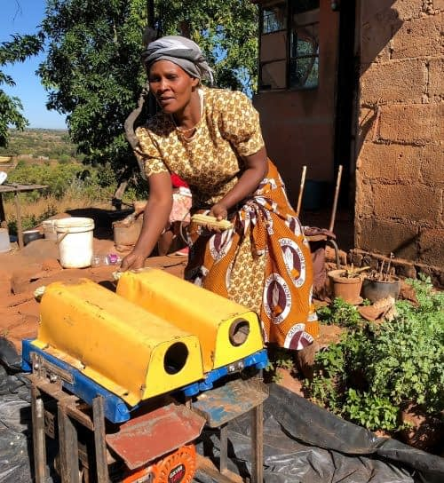 Clara Chikuni has gained a reliable income since becoming a mechanization service provider and offering maize shelling in her local area. (Photo: Matthew O'Leary/CIMMYT)