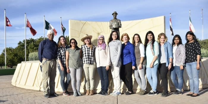 Winners of the Jeanie Borlaug Laube Women in Triticum (WIT) Early Career Award pose in front of the statue of the late Nobel Peace laureate, Dr. Norman E. Borlaug. Included in the photo are Amor Yahyaoui, CIMMYT wheat training coordinator (far left), Jeanie Borlaug Laube (center, blue blouse), and Maricelis Acevedo, Associate Director for Science, the Delivering Genetic Gain in Wheat Project (to the left of Jeanie Borlaug Laube). Photo: CIMMYT/Mike Listman