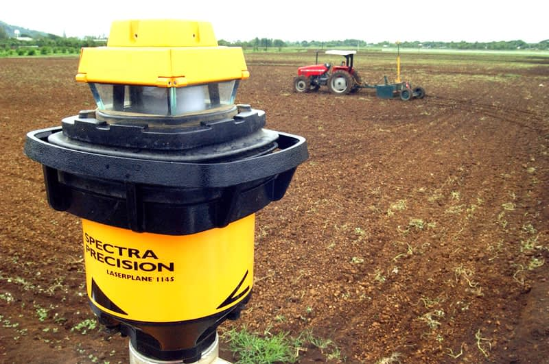 Precision levelers are climate-smart machines equipped with laser-guided drag buckets to level fields so water flows evenly into soil, rather than running off or collecting in uneven land. This allows much more efficient water use and saves energy through reduced irrigation pumping, compared to traditional land leveling which uses animal-powered scrapers and boards or tractors. It also facilitates uniformity in seed placement and reduces the loss of fertilizer from runoff, raising yields. (Photo: CIMMYT)