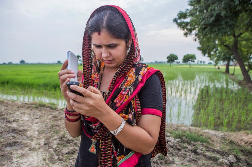 23-year-old Ruby Mehla receives regular updates on weather and climate-smart practices through voice messages on her registered mobile phone in the climate-smart village of Anjanthali, Haryana state, India. (Photo: Prashanth Vishwanathan/CCAFS)